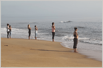 group of kunga yoga teacher training students on outer banks beach