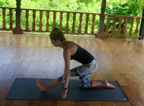duck village yoga instructor performing yoga poses for surfers on the outer banks