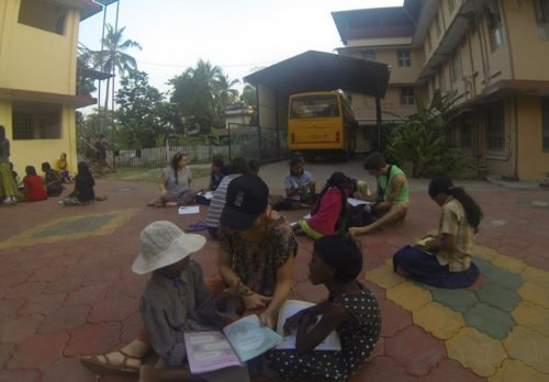 Helping the Girls at Homes of Hope Orphanage with their homework.